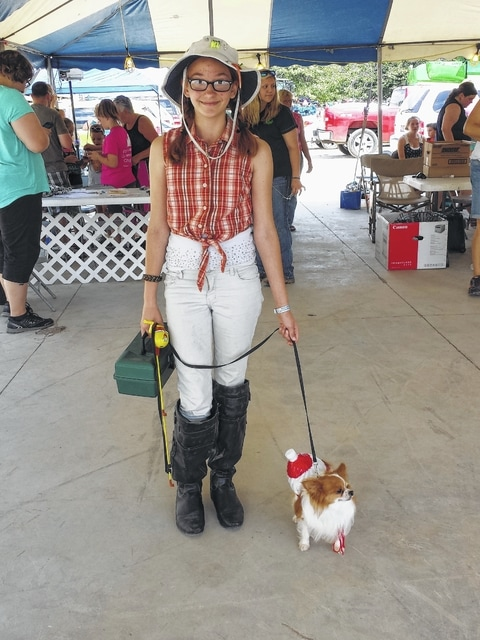 Eva Smalley won the dog costume contest Wednesday during the 2015 Dog Rally and Agility Competition at the Fayette County Fair with her dog Weeble. They depicted a fisherwoman and her bobber in the water.