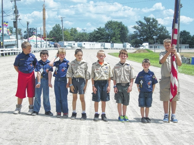A flag folding and retirement demonstration was held in front of the McDonald's Grandstand on Thursday afternoon in recognition of Veterans Appreciation Day at the Fayette County Fair. Here are Fayette County Scouts preparing to present the colors.