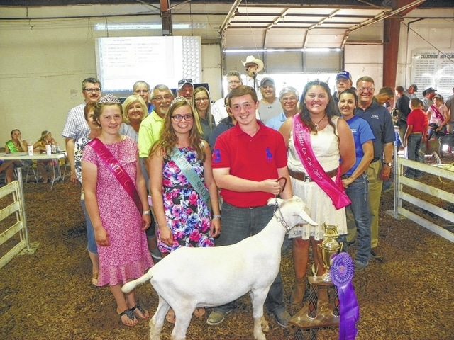 Hayden Walters' Grand Champion Dairy Meat Goat sold for $2,500 on Wednesday evening at the Fayette County Junior Fair Dairy Goat Sale. Pictured with Walters are fair royalty and buyers: (first row) Dairy Princess Victoria Schappacher, Small Animal Queen Ginna Climer, Fair Queen Abbie Noble; (second row) Fayette County Treasurer Susan Dunn, Fayette County Clerk of Courts Evelyn Pentzer, Sid Charles of Gusweiler, Tami Reisinger of LCNB, Michelle Allscott of LCNB, State Rep. Gary Scherer, Janelle Vandyke of Buckeye Propane, Steve Wilson of LCNB; (third row) Keith Tooill of McDonald's, Tim Fogt of Huntington Bank, Buck Minyo of Peoples Bank, Mark Richards of First State Bank, Shane McMahon of State Farm Insurance, and Jared Hoop of Baxla Tractor. A buyer not present was Fifth Third Bank.