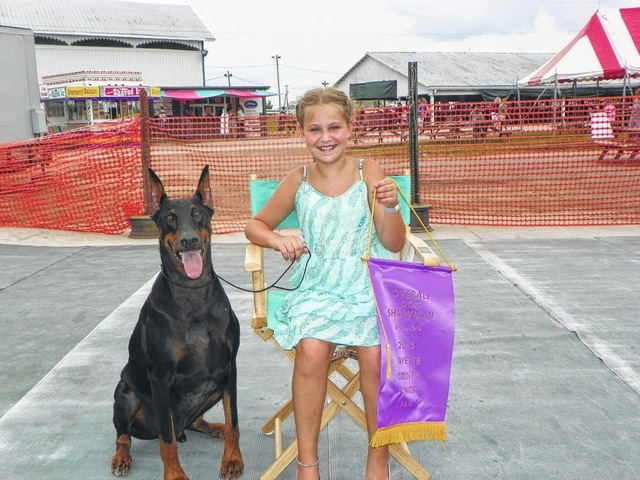"Hayleigh Bageant, 10, won the overall dog showman award at Monday's Fayette County Junior Fair Dog Show. She showed her Doberman, ""Levi,"" at the competition."