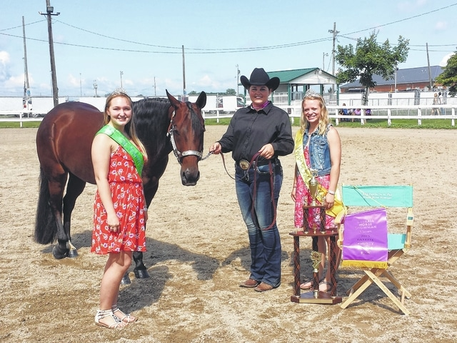 Abbie Noble was named the Overall Horse Showman Tuesday morning during the horse contest after a close competition. She is pictured here with Fair Attendant Alyssa Backenstoe and Fair Attendant Taylor Kirkpatrick.