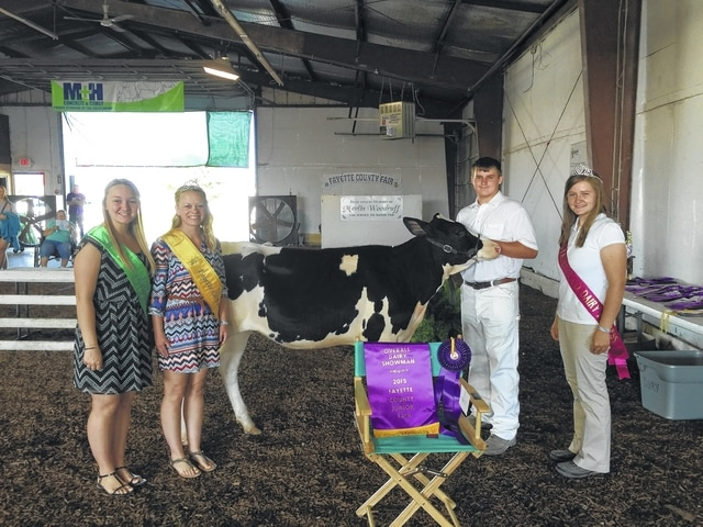 Jack Anders was named Overall Showman during Friday's Junior Fair Dairy Show. Pictured with Anders left to right are: Fair Attendant Alyssa Backenstoe, Fair Attendant Taylor Kirkpatrick, and Dairy Princess Victoria Schappacher.