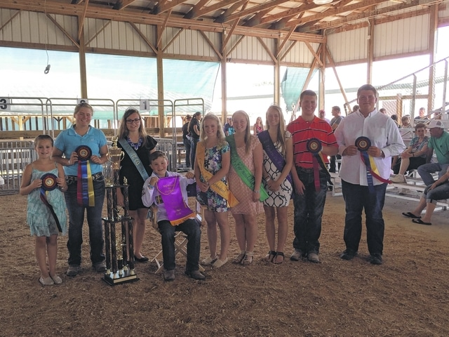 Pictured from left to right are: Hayleigh Bageant, Alexis Schwartz, 2015 Small Animal Queen Ginna Climer, Drew Black, Fair Attendant Taylor Kirkpatrick, Fair Attendant Alyssa Backenstoe, Fair Attendant Emily Daniels, Quinton Waits, and Dylan Page. Black was named Overall Small Animal Showman during Saturday's Junior Fair Small Animal Showman of Showmen Show.