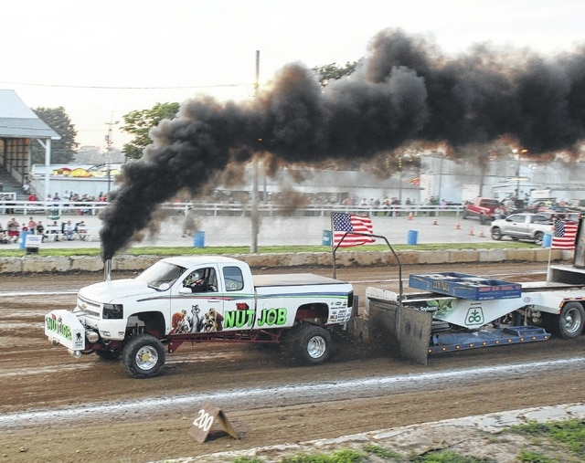 """The stock truck pull drew another very large crowd to the grandstand at the fair Friday, July 24, 2015. Above, in the diesel 3.0 turbocharger class, the truck 'Nut Job', driven by Brian Withrow of Mechanicsburg, took second place with a pull of 351' 5""""."""