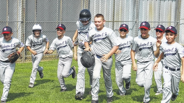 Washington C.H. 10-year-old all-star Tanner Lemaster (holding helmet) is escorted back to the dugout after hitting a three-run home run in the top of the first inning of a District Eight semifinal game against Fairborn Saturday, July 18, 2015 at the Little League complex on Lewis Street. (l-r); Jonah Waters, Tate Landrum, Cole Little, Andrew Guthrie, Tanner Lemaster, Dillon Hyer, A.J. Dallmayer, Tyler Tackage and Collin Southworth. Washington C.H. The all-stars are back in action Wednesday at 6 p.m. when they resume the District Championship game against Enon.