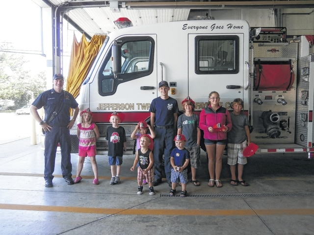 Jeffersonville Branch Library's Community Hero Spotlight was on Aaron Hauer, fire chief of Jeffersonville's fire department. He gave some fire safety tips, such as never play with matches or lighters, in case of a fire, once you are out of the house, stay out. Don't go back for your stuff. The firefighters will try to save the memories for you. The fire department is also offering free smoke detectors. They will install them in your house and the batteries last 10 years. The program began at the library and ended with a tour of the local fire station. Pictured are Jeffersonville Fire Chief Aaron Hauer, Dannielynn Docter, Lane Coe, Jordyn Allen, Dalton Copas, Devin Miller, Jaden Allen, Devon Jenkins, Desirae Pratt and Calvin Miller.