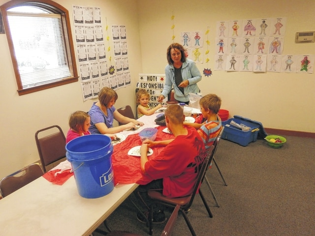 """Did you know that worms have five hearts, no teeth and can eat their weight in a day? Or that there are a million worms in a football field and that worms play an important role in healthy productive soil? These are things the participants of Fayette Soil and Water's Naturalist Educator Brigitte Hisey's """"Worm Workshop"""" found out at Jeffersonville Branch Library recently. They also took a closer look at the soil to learn just what is beneath their feet."""