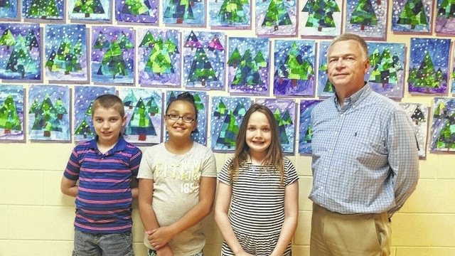 The third grade winners from Belle Aire (left to right): third place Cain Sever, second place Haylee Havens, first place Hayley Long and Judge David Bender.
