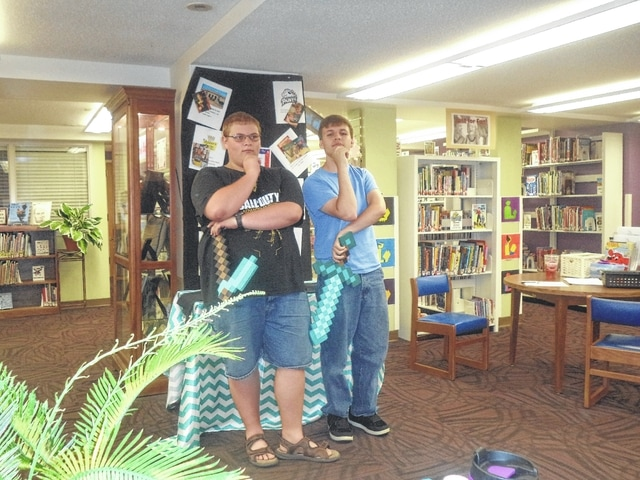 The Carnegie Public Library has been entertaining residents all summer long with an assortment of activities. Alex Behrends and Denver Fawcett hosted two fun programs at the library, Minecraft and Paper Weapons.