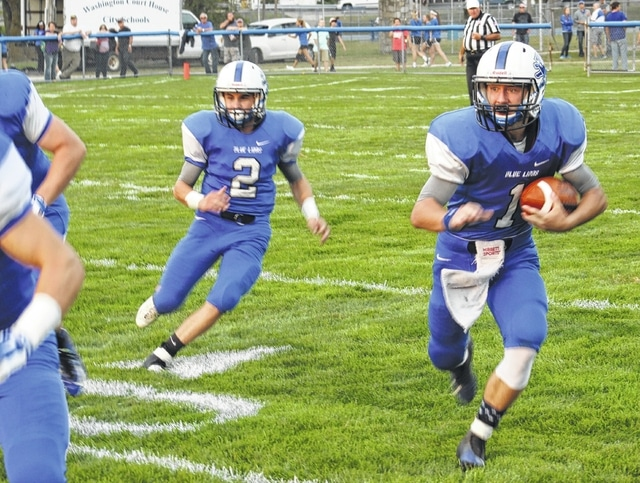 Eric Barden (1) returns the opening kickoff for the Blue Lions in a game against Johnstown Northridge Friday, Aug. 28, 2015 at Gardner Park. Also pictured is fellow senior Caden Cluxton (2).