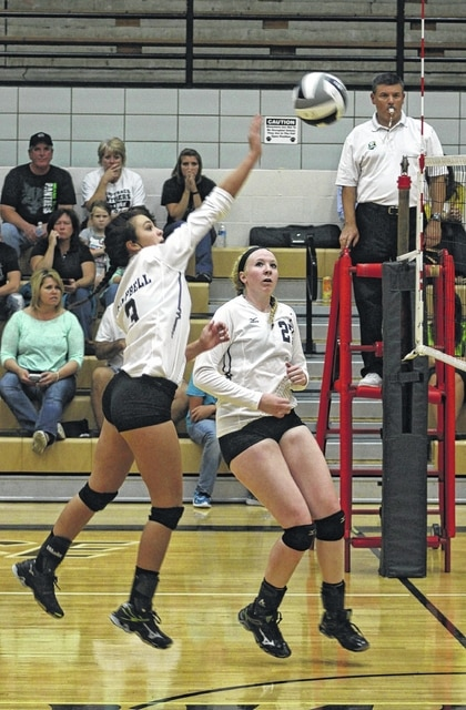 Miami Trace's Kennedy Campbell makes the hit during an SCOL match against Chillicothe Tuesday, Aug. 25, 2015 at Miami Trace High School. Also pictured for Miami Trace is Samantha Ritenour.