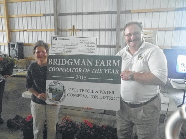 Mary Bridgman was presented with her Cooperator of the Year sign by FSWCD Director Chet Murphy.
