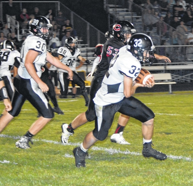 Miami Trace junior Drake Litteral (32) carries for the Panthers during the season-opening game at Circleville Friday, Aug. 28, 2015. Also pictured for the Panthers are junior Lance Mick (30) and junior Corey Olley (38).