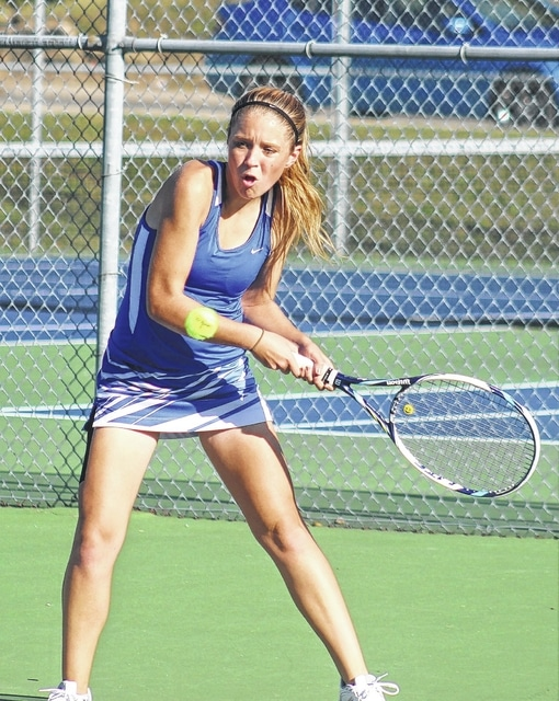 Anna Nestor hits the return for Washington during a doubles match (along with Megan Downing) against Logan Elm Tuesday, Sept. 22, 2015 at Gardner Park.