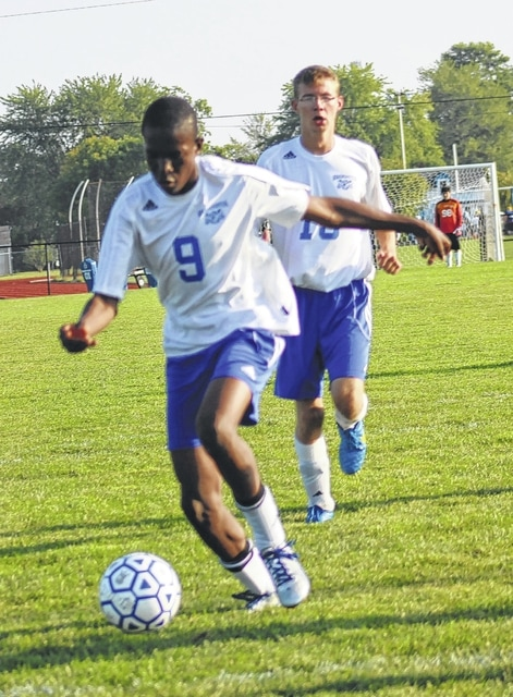 Washington Blue Lion freshman Blaise Tayese (9) sets for the shot at close range against Wilmington during the second half of an SCOL match Tuesday, Sept. 8, 2015. Tayese scored on this attempt and had Washington's goal in the first half of a 6-2 loss to the Hurricane.