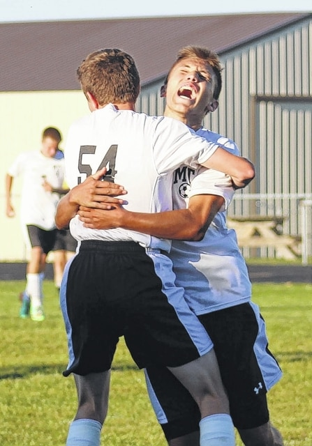 Miami Trace's Blake Pittser exults in the victory after scoring the game-winning goal on a direct kick with 8.7 seconds to play against SCOL opponent Clinton-Massie Thursday, Sept. 10, 2015 at Miami Trace High School. Above, Pittser is congratulated by teammate Nick Elrich.