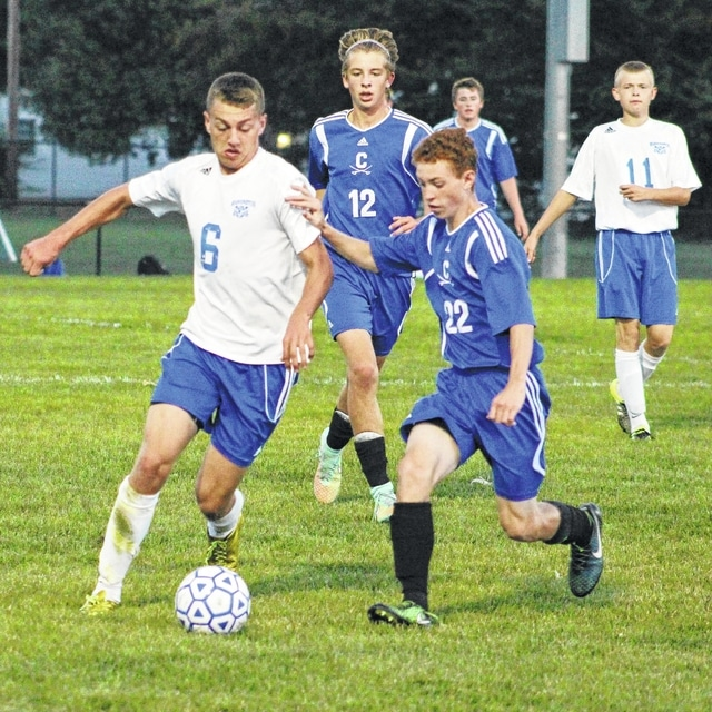Washington senior Cameron Eckles (6) picks up defensive pressure from a Chillicothe player during an SCOL match at Washington High School Tuesday, Sept. 22, 2015. Also pictured for Washington is Jack Luebbe (11).