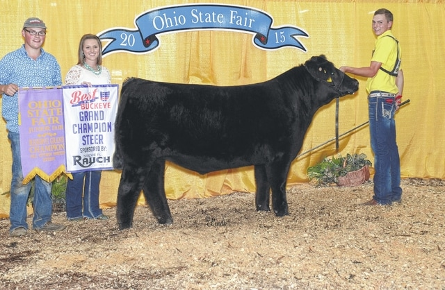 Cole Hiser of Milledgeville earned the title of Champion Simmental Steer during the 2015 Ohio State Fair Best of the Buckeye show. Pictured from left are Matthew Hiser, Hallie Hiser and Cole Hiser.