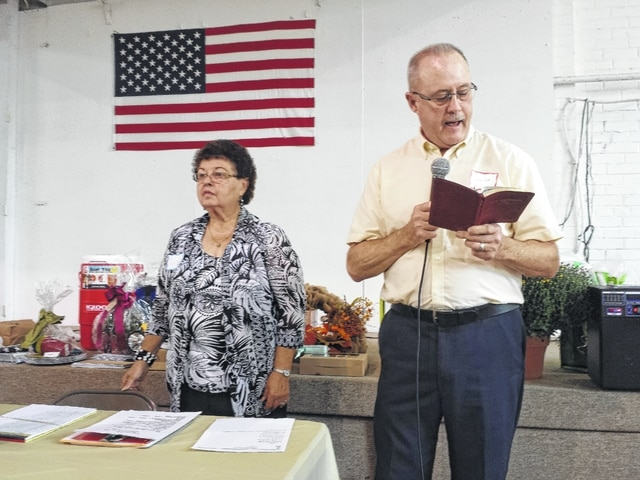Ann Thompson and Larry Doss greet the senior residents who attended the 24th Senior Citizens Day Out, hosted by the New Holland United Methodist Women at the New Holland School on Thursday afternoon. The patrons to the event were treated to a free meal and had the opportunity to win several donated prizes.