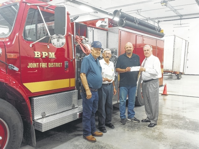 A combination of efforts between the National Elks Foundation and the local Elks Lodge #129 resulted in a donation to help pay for lifesaving firefighting equipment for the Bloomingburg Paint-Marion (BPM) Joint Fire District on Thursday. Equipment the donation will go to help purchase includes basic lifeline sets and a haul pack. Pictured here (L to R): Richard Barton, Elks trustee and fiscal officer for Paint Township, BPM Fire Chief Ron Huff, president of the BPM fire board Larry Dean, and Rowland LeMaster, Elks trustee.