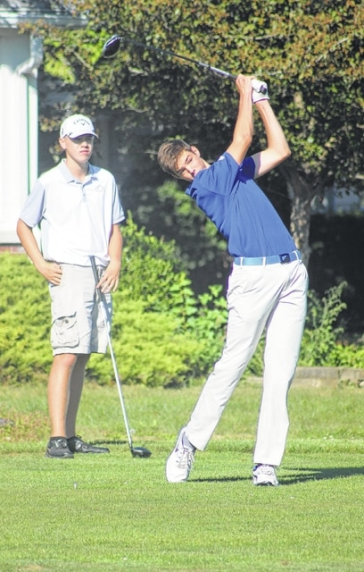 Washington Blue Lion junior Griffin Shaw watches his tee shot on the No. 6 hole at the Club at Quail Run as a player from Wilmington looks on Wednesday, Sept. 23, 2015.