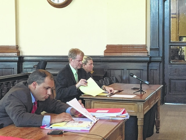 Anna E. Karber sits with her attorney Brent Marshall during her arraignment Monday in Common Pleas Court as Fayette County Prosecutor Jess Weade (left) looks over the indictment.
