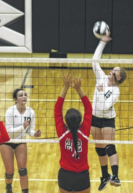 Jessica Camp, at right, makes the hit for Miami Trace during an SCOL match against Clinton-Massie Thursday, Sept. 10, 2015 at Miami Trace High School. Also pictured for Miami Trace is Megan Self.