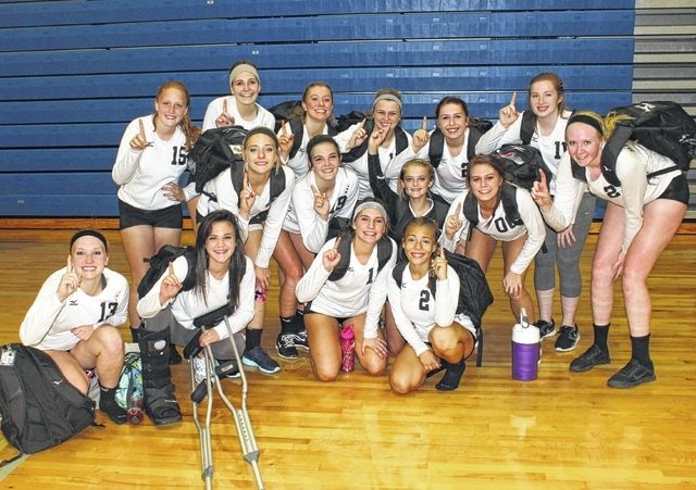 The Miami Trace Lady Panther volleyball team gathers together prior to departing Washington High School after a varsity match win over the Lady Lions Tuesday, Sept. 15, 2015. It is believed that the last time Miami Trace beat Washington in a varsity volleyball match was 1998.