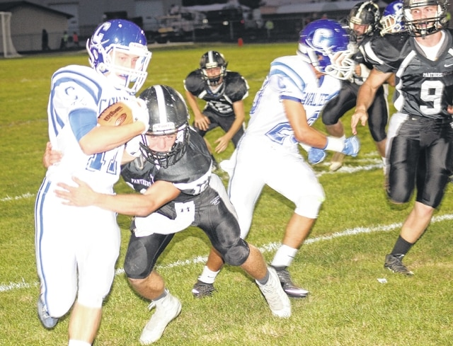 Miami Trace's Coby Hughes comes up and makes the tackle of Chillicothe's Nathan Rosenbauer (at left) during an SCOL game at Miami Trace High School Friday, Sept. 25, 2015. Pictured at right for the Panthers is Jacob Haldeman (9).