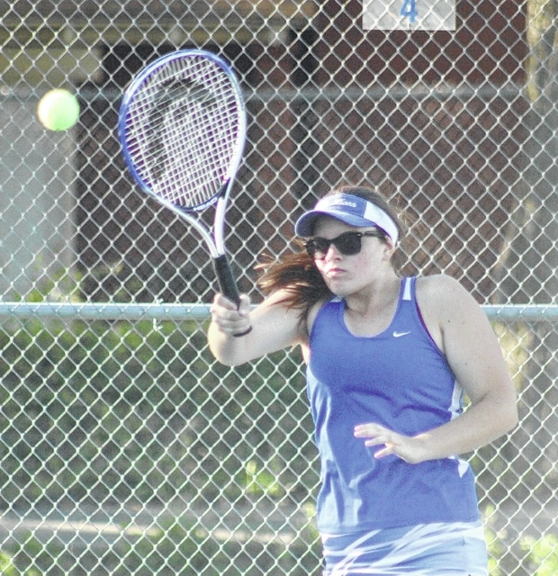 Washington's Mackenzie Cress makes the return during a non-league match against Circelville Monday, Sept. 14, 2015 at Gardner Park.