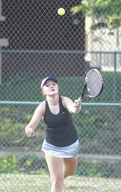 Miami Trace's Maddi Wallace serves during a first doubles match against Washington Tuesday, Sept. 1, 2015 at the courts at Gardner Park.