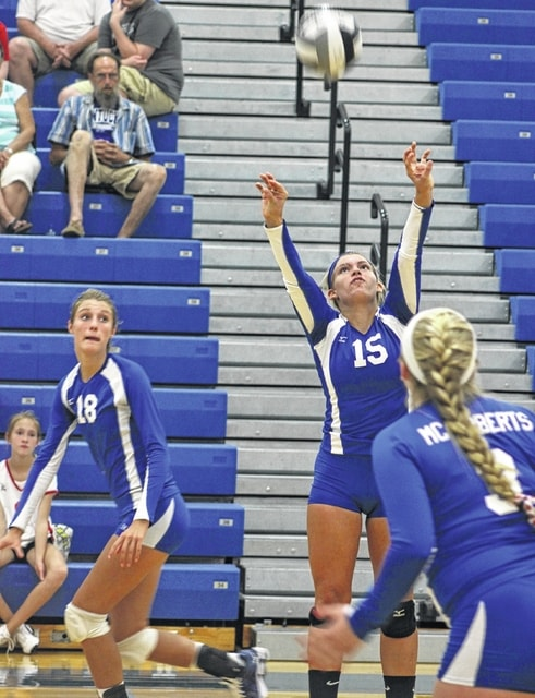 Senior Megan Mullins (15) sets the ball for Washington during an SCOL match against Hillsboro Thursday, Sept. 3, 2015. Also pictured for Washington is sophomore Faith Koble (18) and senior Jaycie McRoberts.