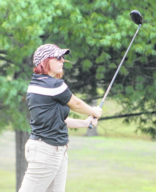 Miami Trace senior Miranda Wheeler watches the flight of her tee shot during the South Central Ohio League tournament Saturday, Sept. 26, 2015 at the Hillsboro Elks Club.
