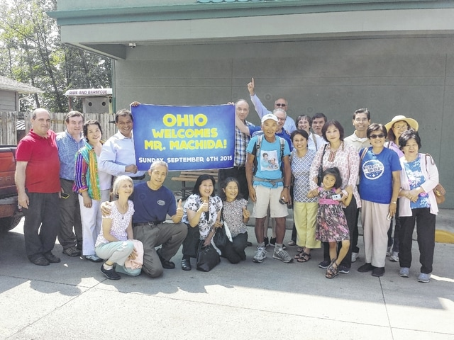 Matsuo Machida (at center in light blue) has been walking since June 25 from San Francisco, Calif. to meet a self-determined deadline of Sept. 18 and arrive at the Washington Monument in Washington D.C. He is pictured here at The Willow in Washington C.H. with local supporters and nationwide followers as they welcome him to Ohio.