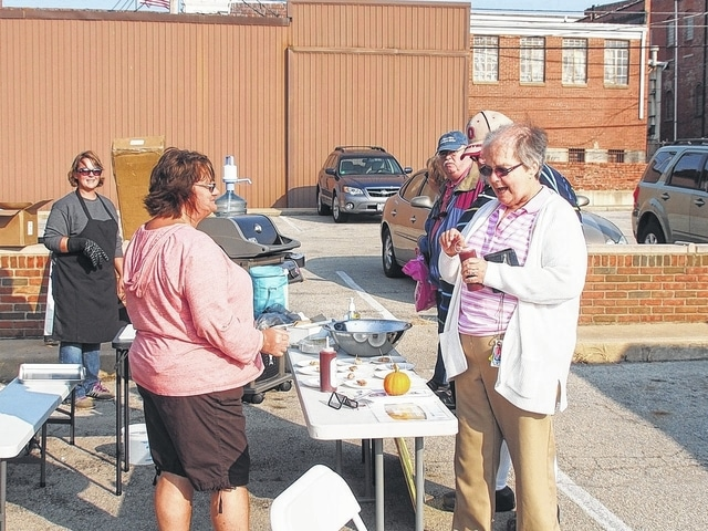 Chicken brats hit the grill plate this year at the Fayette County Farmers Market.