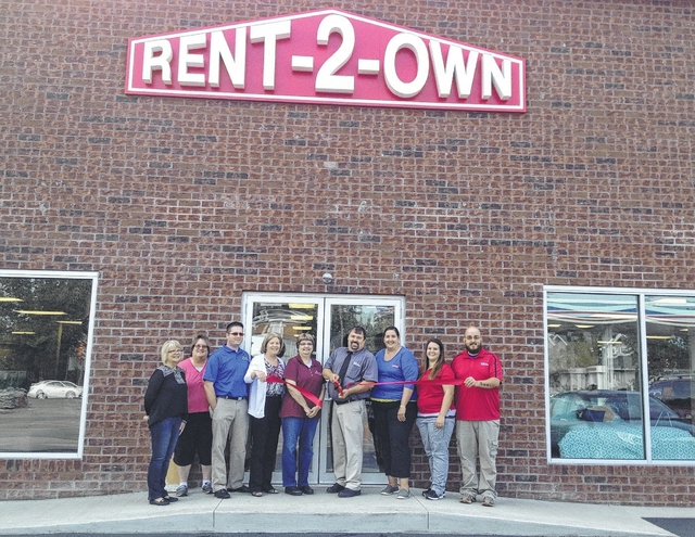 Fayette County Chamber of Commerce member Rent-2-Own recently unveiled its freshly renovated store that includes a brick front, new carpet, windows and a larger showroom floor. Pictured here are various Chamber of Commerce members witnessing the new renovations.
