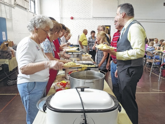 Volunteers and the New Holland United Methodist Women served senior residents a free meal Thursday afternoon as part of the 24th Senior Citizens Day Out.