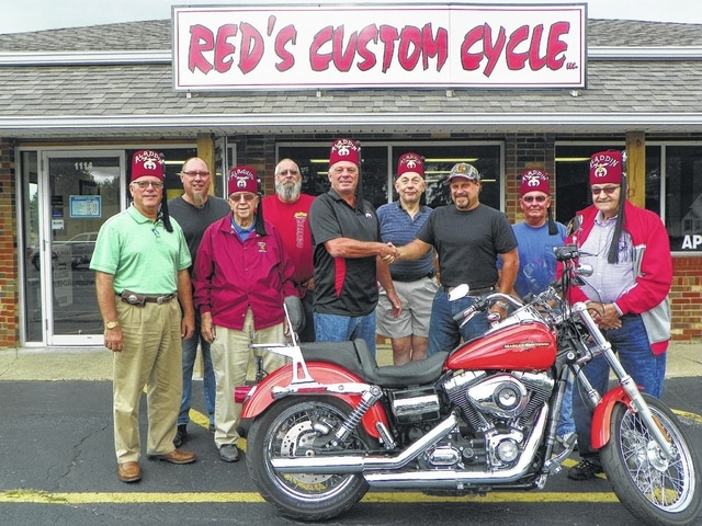 "The Washington Shrine Club raffled away an orange 2012 Harley Davidson Superglide motorcycle recently. Shrine members, the winners of the drawings and Red's Custom Cycle owner, met to give the motorcycle to its new owner. Pictured here (L to R): Benny Jamison, Gary ""Red"" Benson, owner of Red's Custom Cycle; Bus Creamer, Bill ""Pickle"" Terry Jr., winner of the $1,000 second prize; Washington Shrine President Sonny Kearns, Tommy Steltenpohl, Mike Noble, winner of the motorcycle; Steve Simpson and Charlie Dodds. Not pictured is Jeremy Harvey of Greenfield who won the $500 third prize."