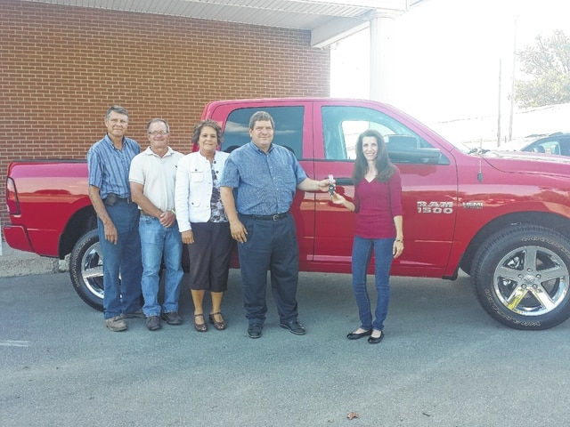 The Fayette County Agricultural Society raffled off a new 2016 Ram 1500 Crew Cab 4x4, valued at $43,000, Saturday evening. Pictured here is the winner Amy Boswell (at right) accepting the keys to her new truck. Also pictured (L to R): senior fair board members Wayne Arnold, Jeff Smithson, senior fair board secretary Faith Cottrill and Doug Marine, of Doug Marine Motors, who donated the truck. The Ag Society appreciates the support from Doug Marine Motors, J.D. Equipment, Custom Cab and the community.