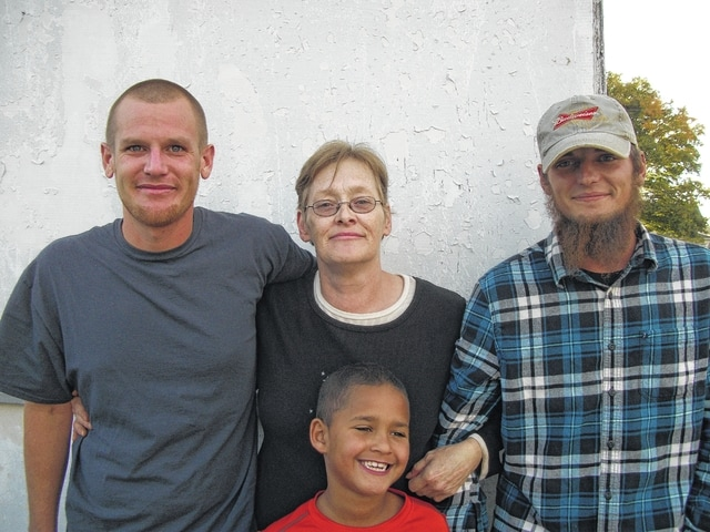 Nina Kelley and her family have invested much time and energy into maintaining Kelley's Tavern in Milledgeville. This weekend is the end of an era for a community staple. Pictured with Nina are Blake Pursley, Britton Bailey and Ian Rayburn.