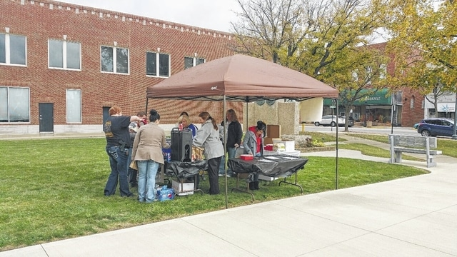 """Employees of the Fayette County Courthouse in Washington C.H. held a """"Tailgate Party"""" Friday on the Courthouse lawn. All proceeds from the event will go to support United Way."""