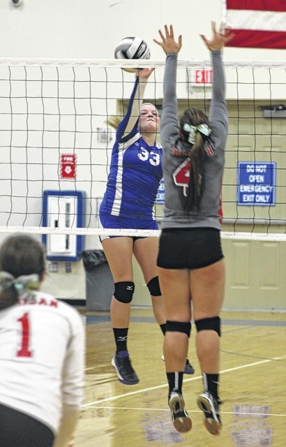 Delaney Greer (33) goes up for the hit at the net for Washington during a Division II Sectional tournament match against Sheridan Wednesday, Oct. 21, 2015 at Washington High School.