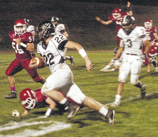 Devin Bainter (22) carries for Miami Trace during an SCOL game at Hillsboro Friday, Oct. 23, 2015. Also pictured for the Panthers is Larry Jackson (3).