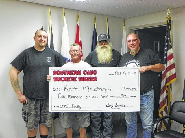 Members of the Southern Ohio Buckeye Bikers (SOBB) met with Kevin Mossbarger at the Fayette County Veterans Office to donate $2,000 to him. Mossbarger accepted the check with a big smile and thanked the donors for the assistance. Pictured here (L to R): SOBB Treasurer DJ Jenkins, local veteran Kevin Mossbarger, SOBB Secretary Jim Morrison and SOBB President Gary Benson.
