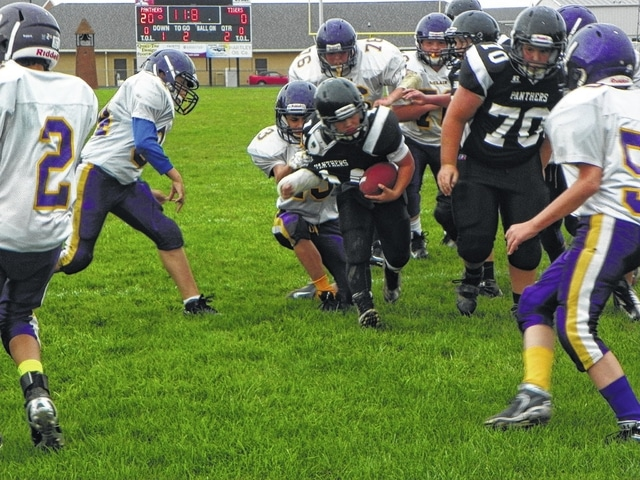 Camron Lacure (ball carrier) scores the fourth touchdown for the Miami Trace seventh grade team versus McClain Tigers Wednesday evening at Miami Trace, a game the team won.