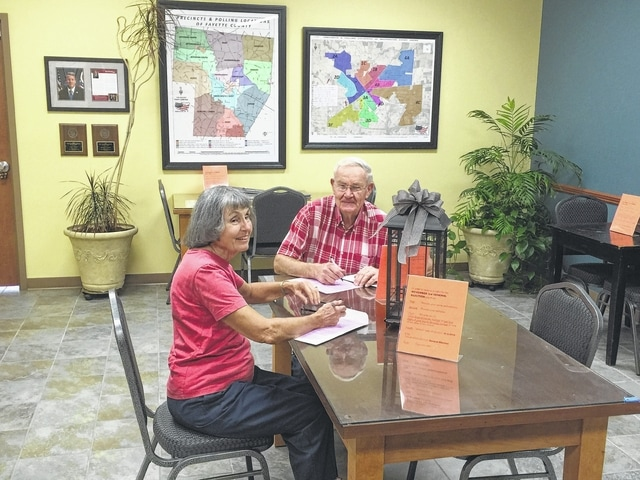 Pauline and Paul McClish came Tuesday afternoon to vote early at the Board of Elections.