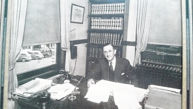 Troy T. Junk, founder of Junk & Junk Attorneys, sits in his office, which originally started in the masonic building, but in 1979 was moved to its current location on North Main Street. For more information on the firm, contact William T. Junk at 740-335-3231.