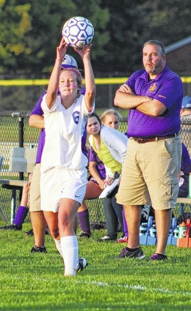 Kayla Kimmet enters the ball for Washington during an SCOL match against the McClain Lady Tigers Tuesday, Oct. 6, 2015. Looking on is McClain head coach Shawn Peterman.