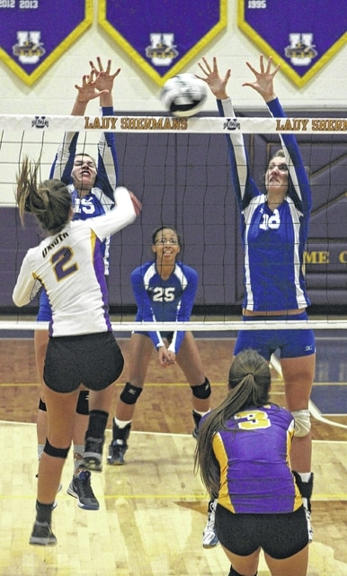 Washington's Megan Mullins (left) and Faith Kobel (right) combine for a block against Unioto during a Division II Sectional championship match at Unioto High School Saturday, Oct. 24, 2015. Also pictured for Washington is Maria Wilson.