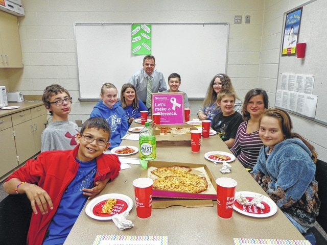 "Donatos recently provided pizza to these students at Washington Middle School as they celebrated ""Pizza with the Principals."" This is in appreciation for their selection as Students of the Month for October. They are chosen by their teachers because of the outstanding example they set for their peers in such areas as academic effort, good work ethic, kindness to others, and service to their school. Pictured here (left to right): Skylor Mitchell, Broc Leasure, Abby Tackage, Shawna Conger, Mr. Montgomery, assistant principal, Ty Rose, Sarah Anders, Hunter Hubbell, Ashton Yoakum and Katie Kotlinski."